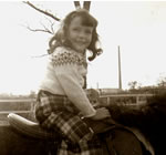 Riding a Donkey - Age 5